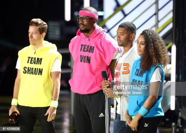 Olympic snowboarder Shaun White, NFL player Von Miller, host Russell Wilson, and WNBA player Skylar Diggins-Smith speak onstage during Nickelodeon...