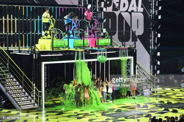 Olympic snowboarder Shaun White WNBA player Skylar DigginsSmith and NFL player Von Miller ride exercise bikes to slime audience members onstage...