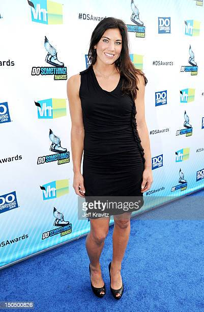 Olympic soccer player Hope Solo arrives at DoSomethingorg and VH1's 2012 Do Something Awards at Barker Hangar on August 19 2012 in Santa Monica...