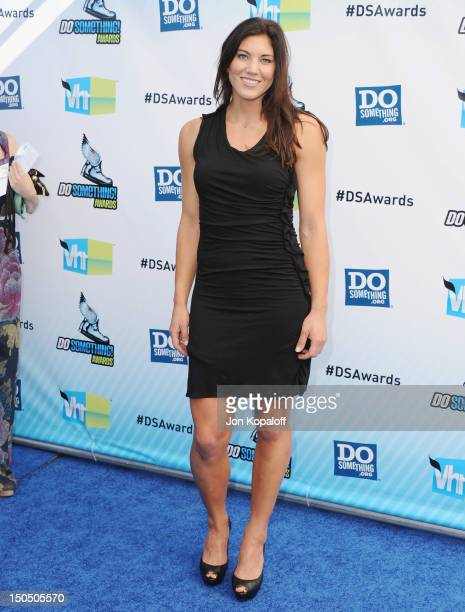 Olympic Soccer player Hope Solo arrives at the DoSomethingorg And VH1's 2012 Do Something Awards at the Barker Hangar on August 19 2012 in Santa...