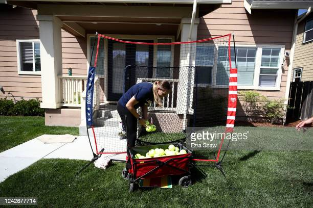 Olympic softball pitcher Monica Abbott takes ball out of a net during a training session on June 02 2020 in Salinas California Abbott was on the...