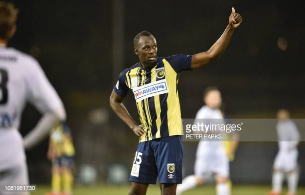 TOPSHOT Olympic sprinter Usain Bolt acknowledges the crowd as he celebrates scoring his second goal for ALeague football club Central Coast Mariners...