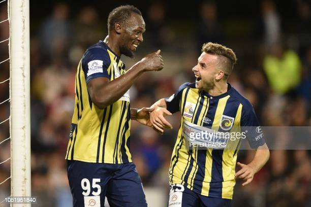 TOPSHOT Olympic sprinter Usain Bolt celebrates scoring his second goal with teamate Jordan Murray for ALeague football club Central Coast Mariners in...