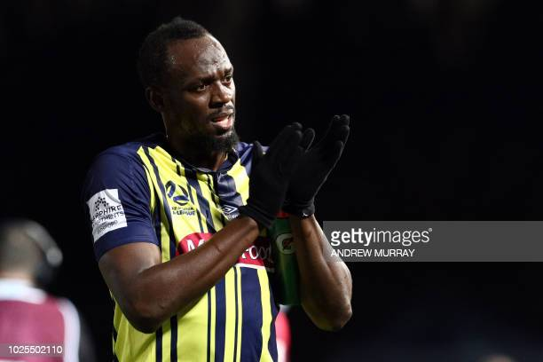 Olympic sprinter Usain Bolt gestures as he plays for A-League football club Central Coast Mariners in a pre-season practice match against a Central...