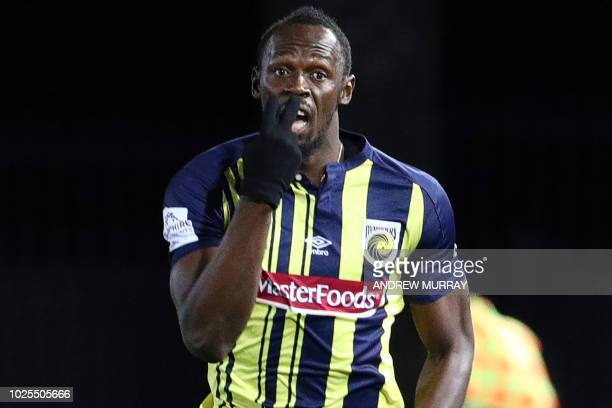 Olympic sprinter Usain Bolt gestures as he plays for ALeague football club Central Coast Mariners in a preseason practice match against a Central...