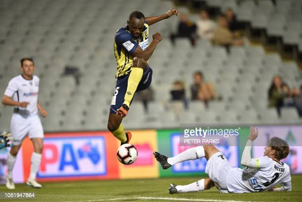 TOPSHOT Olympic sprinter Usain Bolt playing for ALeague football club Central Coast Mariners jumps while controlling the ball in his first...
