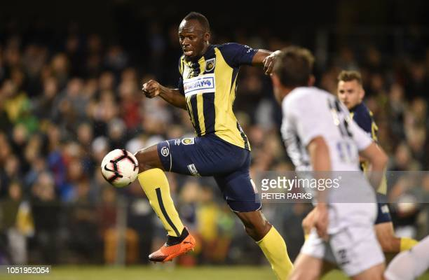 TOPSHOT Olympic sprinter Usain Bolt playing for ALeague football club Central Coast Mariners shoots on goal against Macarthur South West United in...