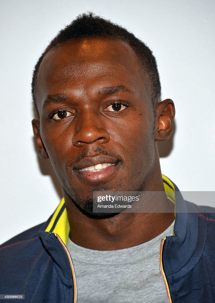 "Usain Bolt Signs Copies Of His Autobiography ""Faster Than Lightning: My Autobiography"" At PUMA Store"