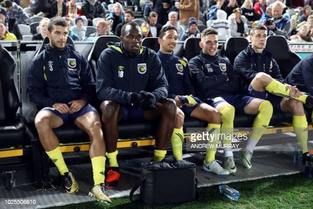 TOPSHOT Olympic sprinter Usain Bolt sits on the bench as he waits to play for ALeague football club Central Coast Mariners in a preseason practice...