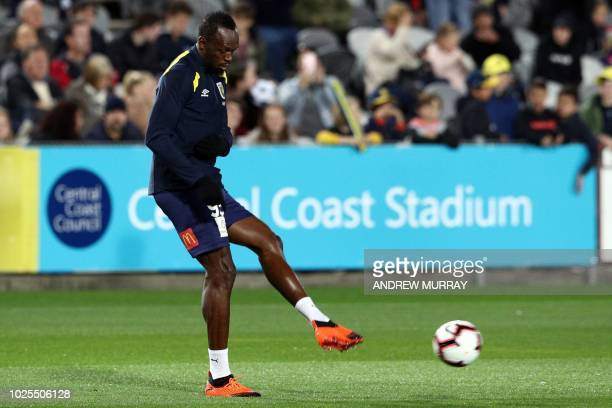 Olympic sprinter Usain Bolt warms up before he plays for ALeague football club Central Coast Mariners in a preseason practice match against a Central...