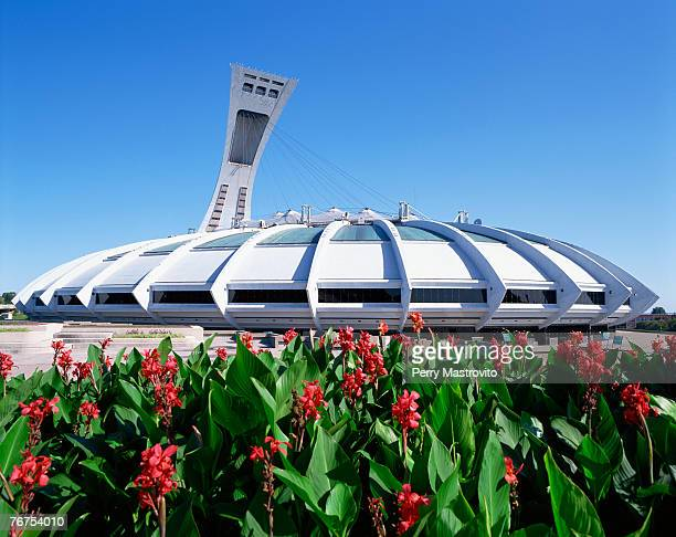 Olympic Stadium and red flowers, Montreal, Quebec, Canada