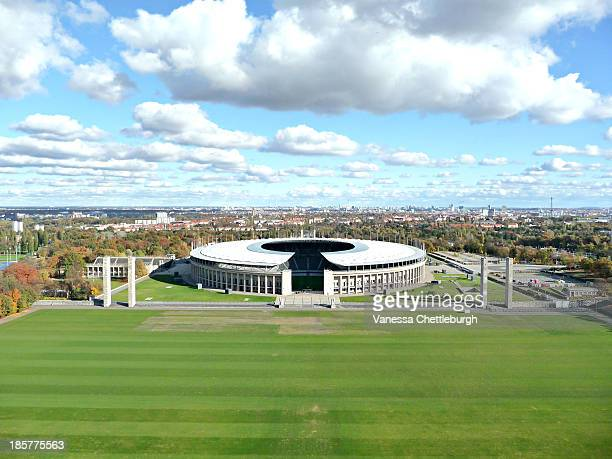 CONTENT] Olympic Stadium Berlin blue sky fluffy white clouds Autumn