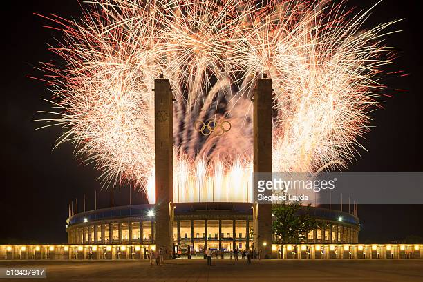 olympic stadium with fireworks - olympiastadion berlin stock pictures, royalty-free photos & images