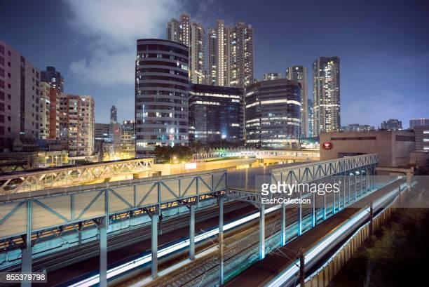 Olympic Station and skyline of Hong Kong at night