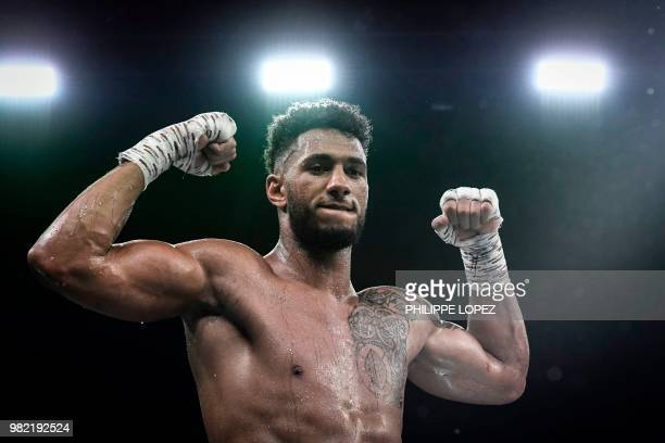 Olympic super heavyweight gold medalist Tony Yoka of France celebrates after defeating British domestic level heavyweight Dave Allen during their...