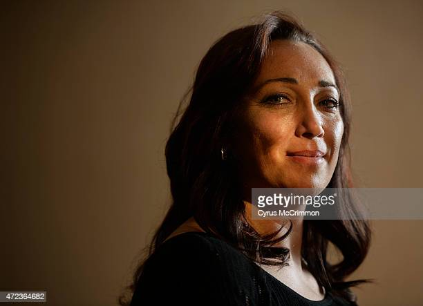 Olympic swimmer and Colorado native Amy Van DykenRouen did a portrait on Wednesday May 6 2015 after speaking at the Bayaud Enterprises' 23rd annual...