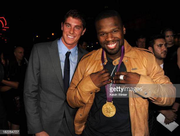 Olympic swimmer Conor Dwyer and rapper 50 Cent arrive at the premiere of Open Road Films' 'End of Watch' at Regal Cinemas LA Live on September 17...