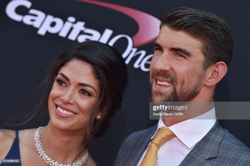 Olympic swimmer Michael Phelps and model Nicole Johnson arrive at the 2017 ESPYS at Microsoft Theater on July 12, 2017 in Los Angeles, California.