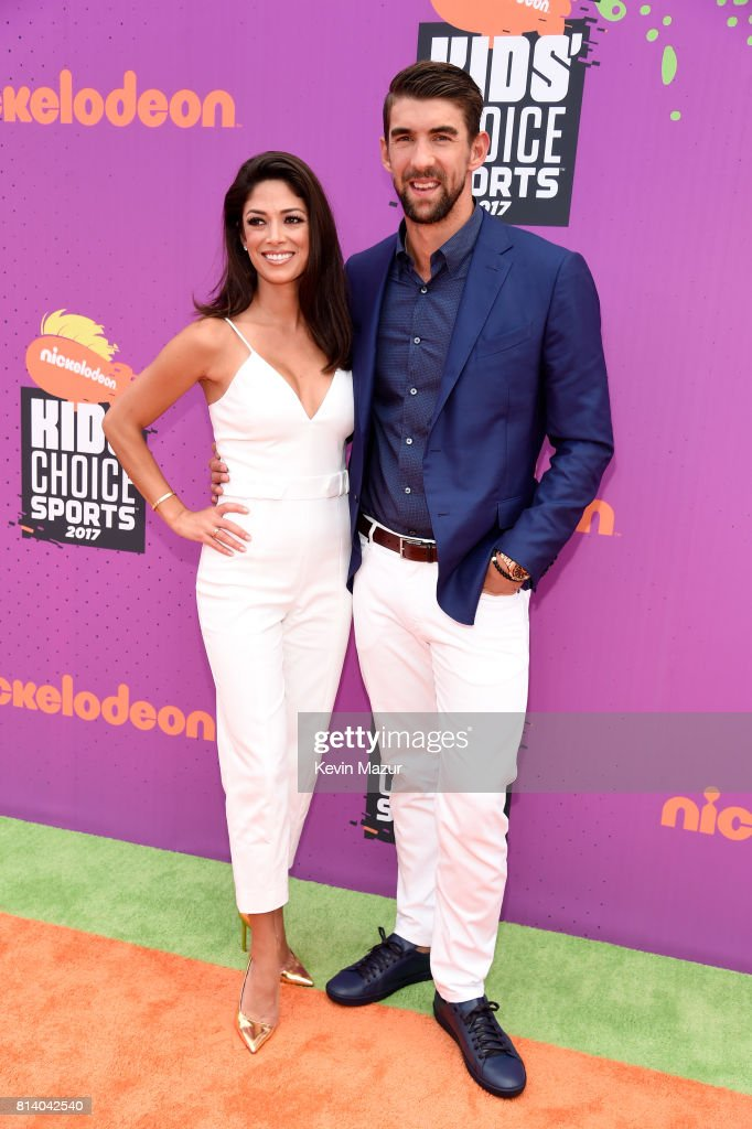Olympic swimmer Michael Phelps (R) and model Nicole Johnson attend Nickelodeon Kids' Choice Sports Awards 2017 at Pauley Pavilion on July 13, 2017 in Los Angeles, California.
