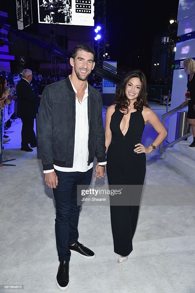 Olympic swimmer Michael Phelps and Nicole Johnson attend the 2016 MTV Video Music Awards on August 28, 2016 in New York City.