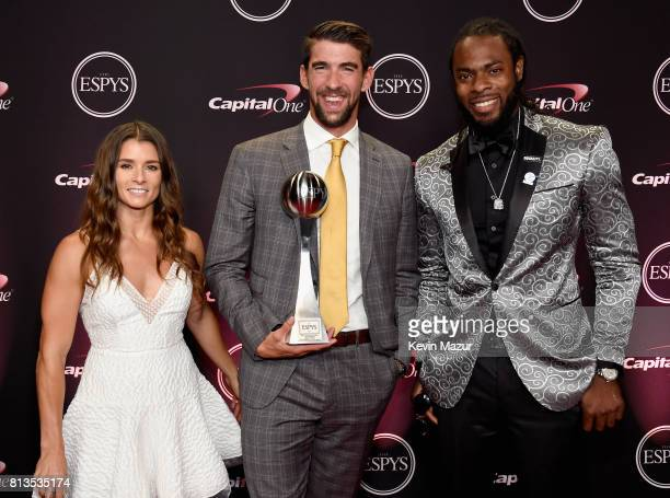 Olympic swimmer Michael Phelps winner of the Best RecordBreaking Performance award with race car driver Danica Patrick and NFL player Richard Sherman...