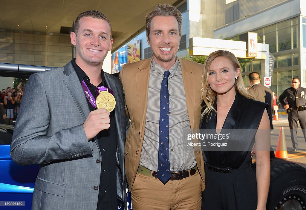 Olympic swimmer Tyler Clary, actor Dax Shepard and actress Kristen Bell arrive to the premiere of Open Road Films' 'Hit and Run' on August 14, 2012 in Los Angeles, California.