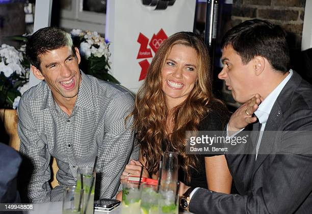 US Olympic swimmers Michael Phelps Natalie Coughlin and Russian Olympic swimmer Alexander Popov attend 'Spotlight On Swimming' at OMEGA House OMEGA's...