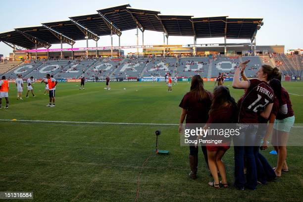 Olympic swimming gold medalist Missy Franklin and her Regis High School classmates watch warm ups as they attend the match between the Portland...