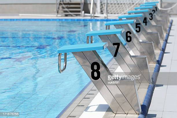 olympic swimming pool start line - the olympic games stock pictures, royalty-free photos & images