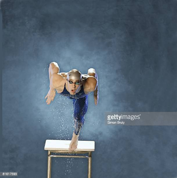 Olympic Swimming Portrait of USA Michael Phelps jumping from block at pool Baltimore MD 2/20/2004 CREDIT Simon Bruty