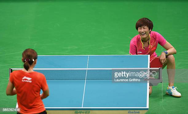 Olympic Table Tennis player Ning Ding of China shares a joke with Shiwen Liu during practice at Riocentro Pavilion on August 2, 2016 in Rio de...