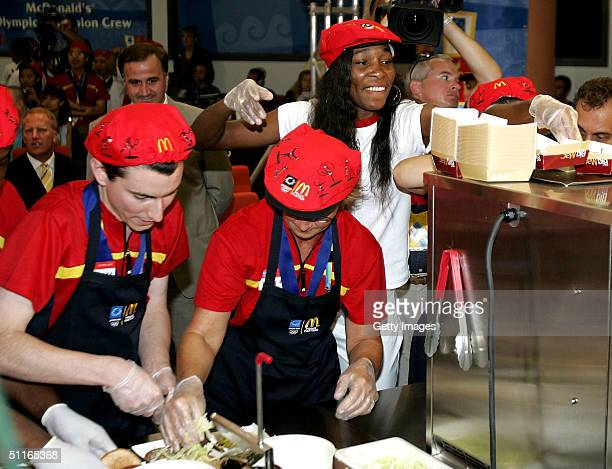 Olympic tennis star Venus Williams shows the McDonald's Olympic Champion Crew the techniques for making the perfect Big Mac at the Main Press Center...