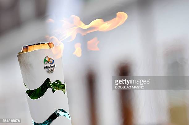 TOPSHOT Olympic torch arrives in Ouro Preto historic city of Minas Gerais Brazil on May 13 2016 / AFP / DOUGLAS MAGNO