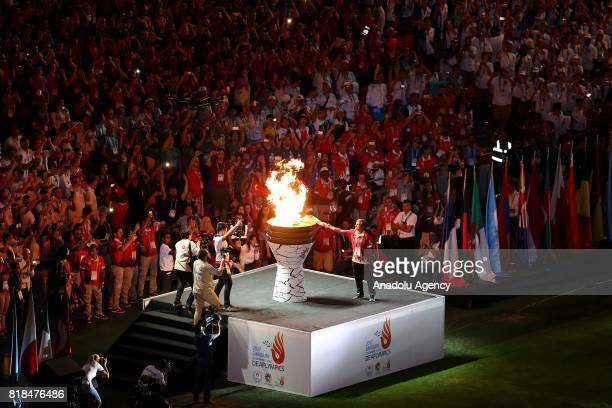 Olympic torch is lighted during the opening ceremony of Deaflympics at 19 Mayis Stadium in Samsun Turkey on July 18 2017 Samsun will be hosting...