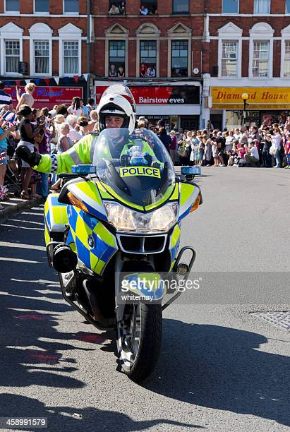 Olympic Torch Relay - police high-fives