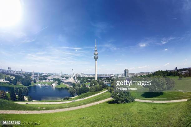 Olympic Tower in park under blue sky, Munich, Germany