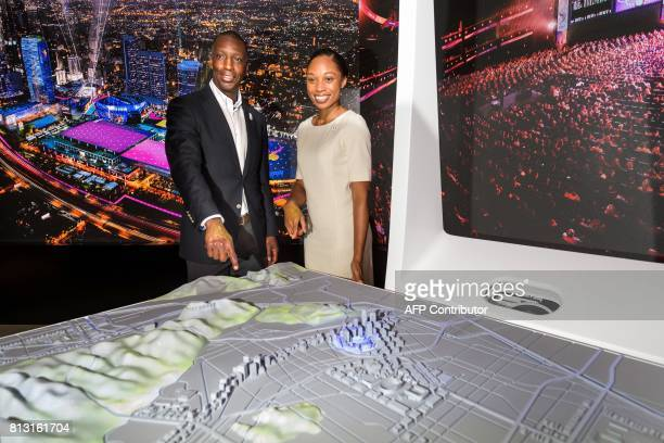US Olympic track and field athletes Michael Johnson and Allyson Felix pose next to a scuale model of Los Angeles during the presentation of Los...