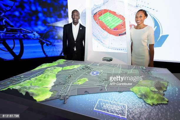 US Olympic track and field athletes Michael Johnson and Allyson Felix pose next to a scale model of Los Angeles during the presentation of Los...