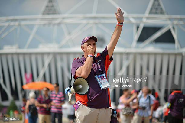 Olympic volunteer Kostus Ruffy talks to the crowd through his mega phone on August 10 2012 in London England Thousand of Olympic volunteers have...