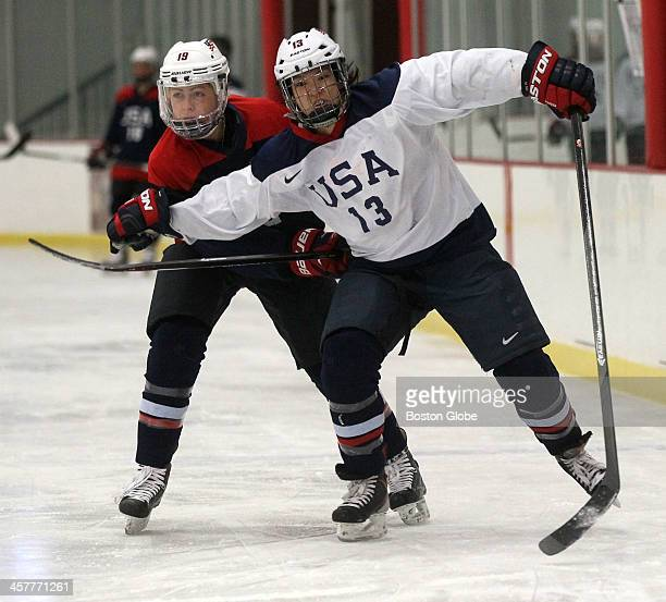 Olympic women's hockey player Julie Chu battles with teammate Gigi Marvin , left, at the Edge Sports Center in Bedford.