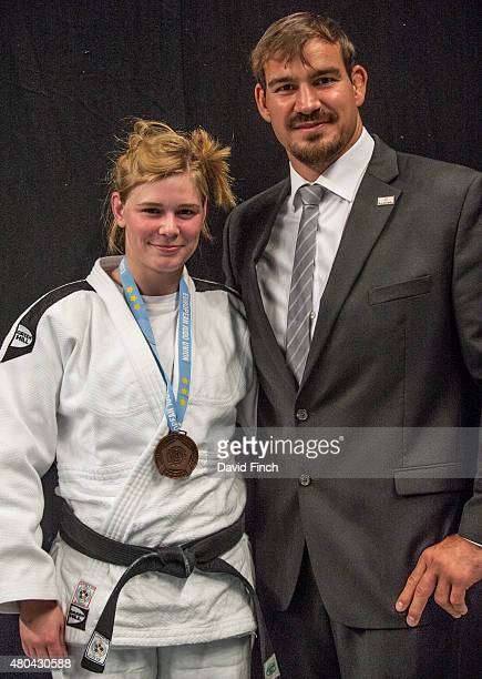 Olympic World and European medallist Andreas Toelzer of Germany proudly stands alongside Sheena Zander who he coached to the u63kg bronze medal...