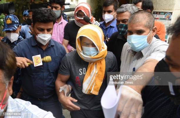 Olympic wrestler Sushil Kumar and his associate Ajay Kumar in the custody of Delhi Police Special Cell on May 23, 2021 in New Delhi, India. Evading...