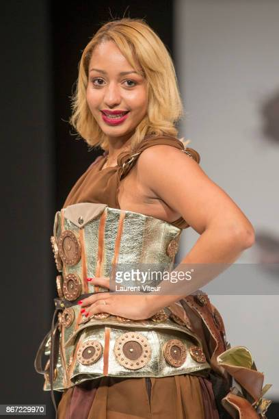 Olympics Boxe Champion Estelle Mossely walks the Runway during Le Defile des Robes en Chocolats during the Salon du Chocolat Paris 2017 at Parc des...