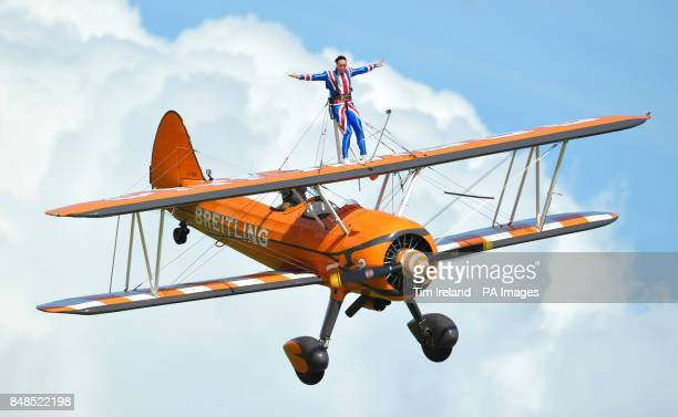 Olympics Bronze medalist Beth Tweddle wingwalking with the Breitling team at RFC Rendcomb Airfield near Cirencester Gloucestershire