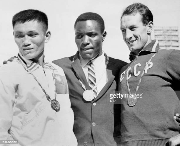 Olympics Decathlon medalists stand on the podium Rome 08 September 1960 US Rafer Johnson won gold Taiwan Yang ChuanKwang took silver and USSR Vassily...