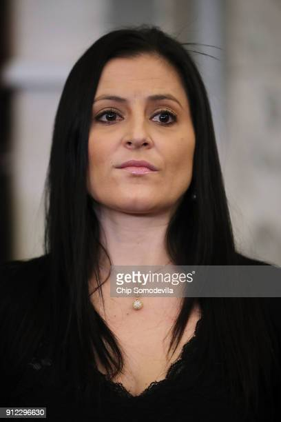 S Olympics gold medalist Dominique Moceanu participates in a news conference to discuss new legislation to protect athletes in the Russell Senate...