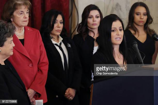 S Olympics gold medalist Dominique Moceanu speaks during a news conference to discuss new legislation to protect athletes with Sen Dianne Feinstein...