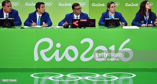 Olympics' judges look on during a Women's quarterfinal basketball match between France and Canada at the Carioca Arena 1 in Rio de Janeiro on August...