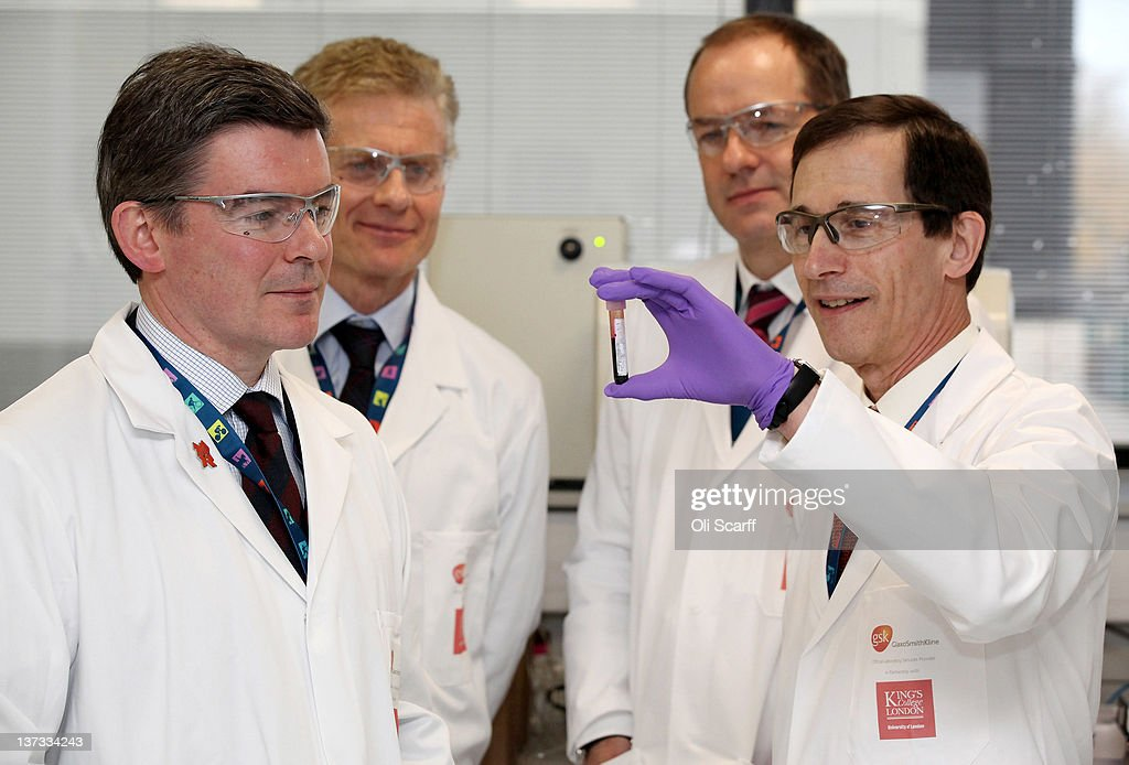 Olympics minister Hugh Robertson (L), Paul Deighton (2nd L), London 2012 Chief Executive and Sir Andrew Witty (2nd R), CEO of GSK, are shown a vial of blood by Professor David Cowan, the Head of Science for London 2012 and Director of King's College London's Drug Control Centre, in the anti-doping laboratory which will test athlete's samples from the London 2012 Games on January 19, 2012 in Harlow, England. The facility, which will be provided by GSK and operated by King's College London, will test over 6250 samples throughout the Olympic and Paralympic Games. Over 150 anti-doping scientists will work in the laboratory, which measures the size of seven tennis courts, 24 hours a day.