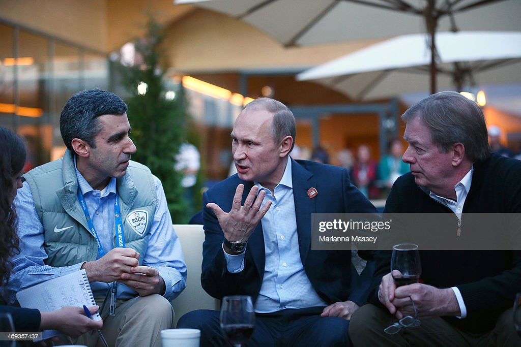 Olympics President Gary Zenkel, Russian President Vladimir Putin and U.S. Olympic Committee chairman Larry Probst visit USA House in the Olympic Village on February 14, 2014 in Sochi, Russia.